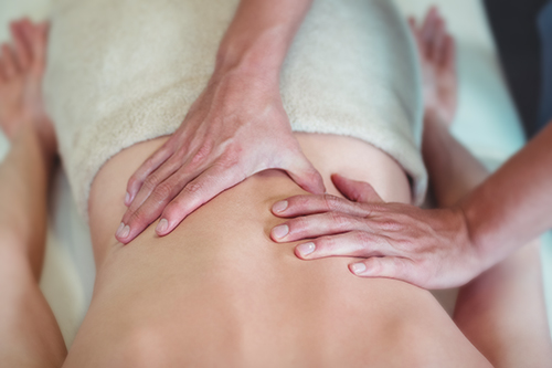 Reduce Low back pain with therapeutic massage